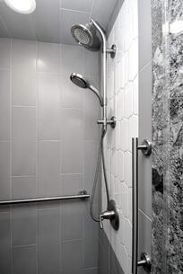 Gray Shower Tile with White Accent and Grab Bars
