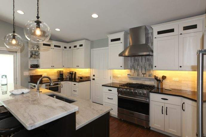 beautifully-remodeled-kitchen-with-island-and-lit-cabinetry